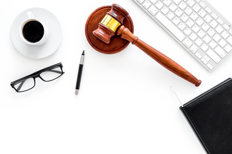 desktop for lawyer keyboard notebook glasses pen