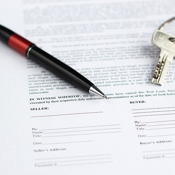 real estate contract pen and key